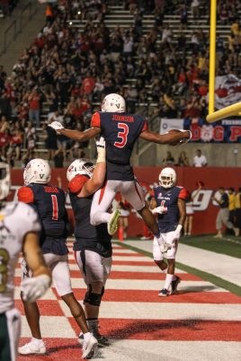 Fresno State receiver KeeSean Johnson celebrates with an offensive lineman after scoring a touchdown in the fourth quarter. (Nick Baker/Clovis Roundup)