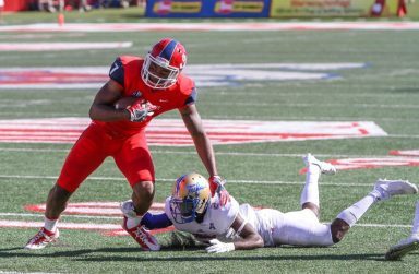 Fresno State senior wide receiver Aaron Peck looks to break free with a Tulsa defender at his feet during the Bulldogs' 48-41 double overtime loss to the Hurricane Saturday at Bulldog Stadium. [Photo by Nick Baker]
