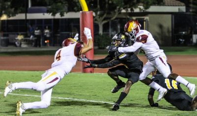 Golden Eagles No. 3 Tykee Woods and No. 4 Diego Cruz attempt to break up a pass against Edison in the team's 26-20 victory to improve the team's record to 2-1 on the season. (Nick Baker/Clovis Roundup)