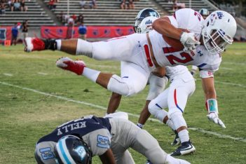 Blake Wells is upended after a nice gain in Buchanan's 28-17 win over Bullard. Well, a senior, is an important part of the Bears attack this season, returning punts and playing wide receiver.  [Nick Baker/Clovis Roundup]