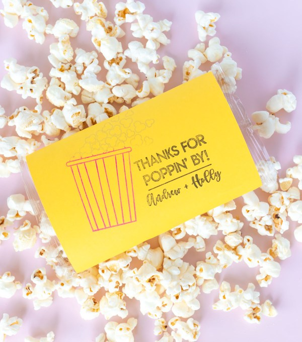 "DIY Stamped Popcorn Favors for Weddings | Make your own DIY wedding favors with microwave popcorn! These cute ""thanks for POPPING by"" popcorn wedding favors use a custom stamp from RubberStamps.com to make a favor guests can easily enjoy at home! #ad #weddingdiy #weddingfavor #partyfavor #stamping #popcorn #papercrafts #diyparty #handmadewedding #colorfulwedding"