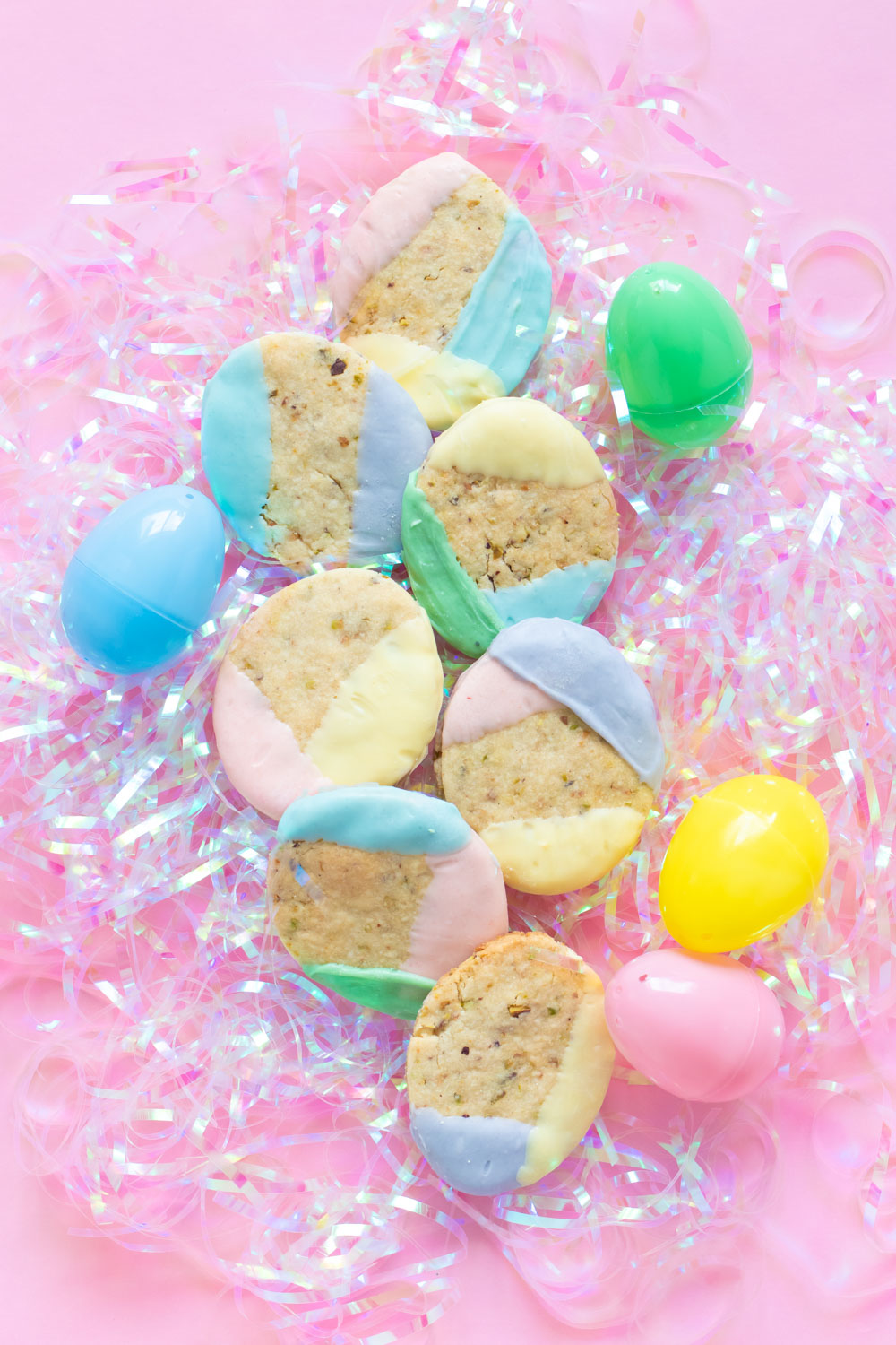Layered Easter color blocked cookies on shredded plastic