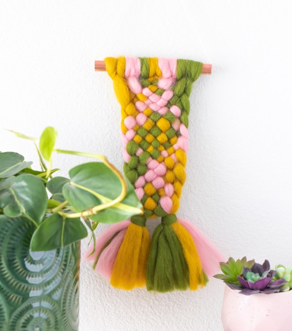 roving weaving wall hanging on white wall