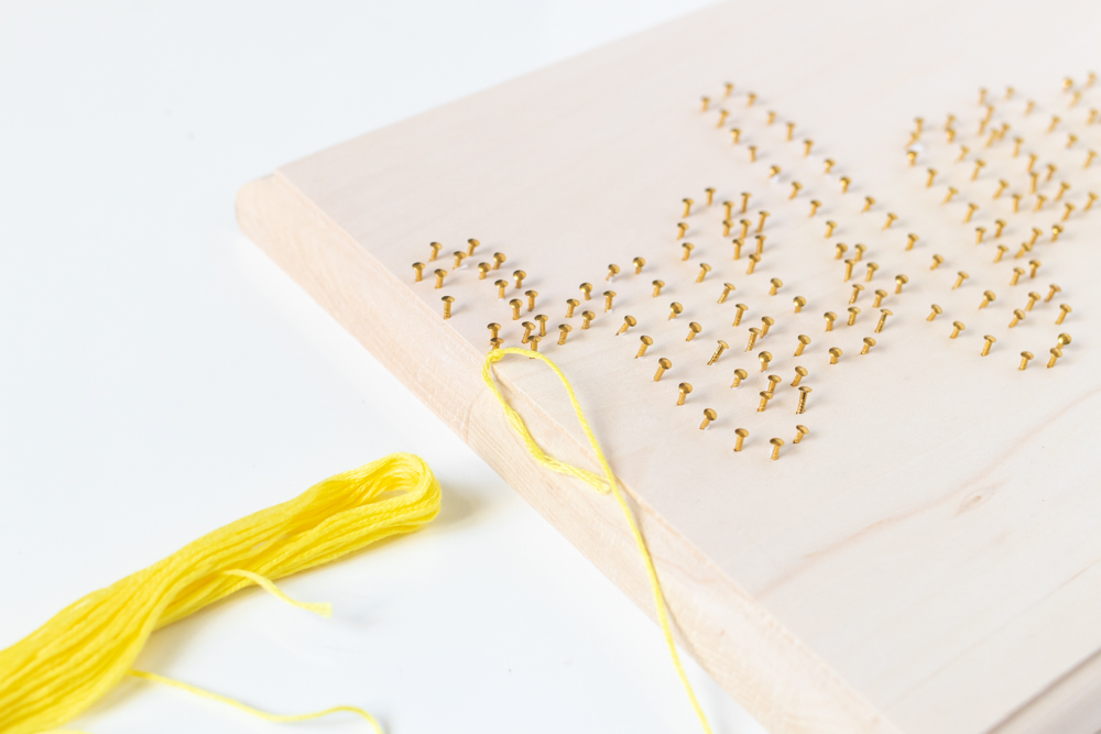 knot with embroidery thread around a nail