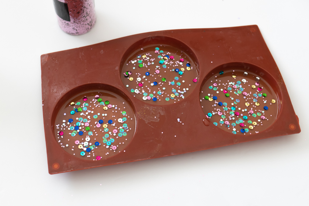 confetti sprinkled on resin coasters in mold