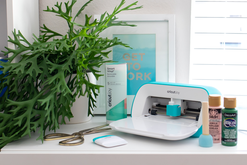 Cricut Joy with vinyl and craft supplies for making stenciled side table