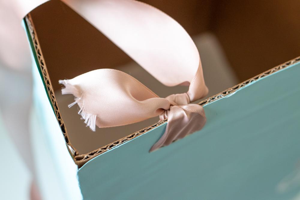 tying ribbon straps for cardboard box costume