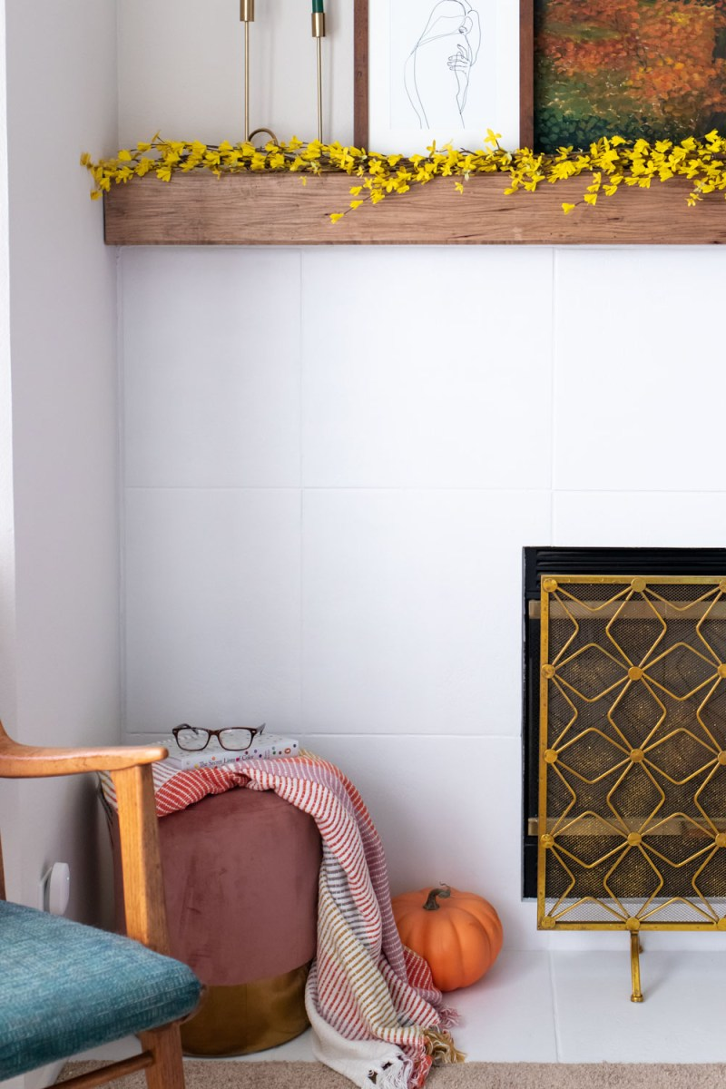 view of white painted tile fireplace with modern decor