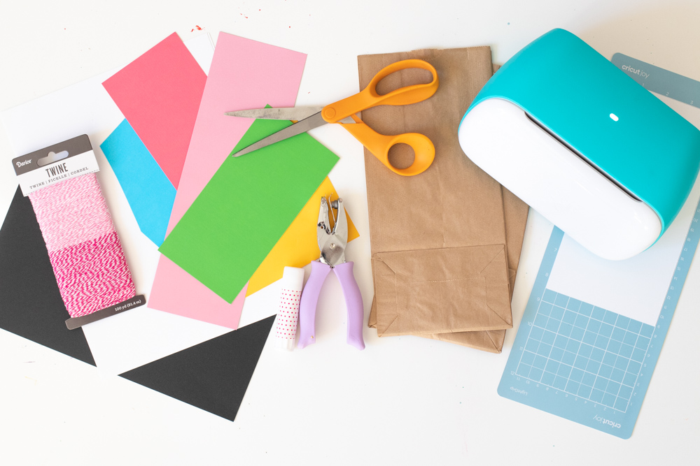 supplies for making gingerbread house paper gift bags with Cricut