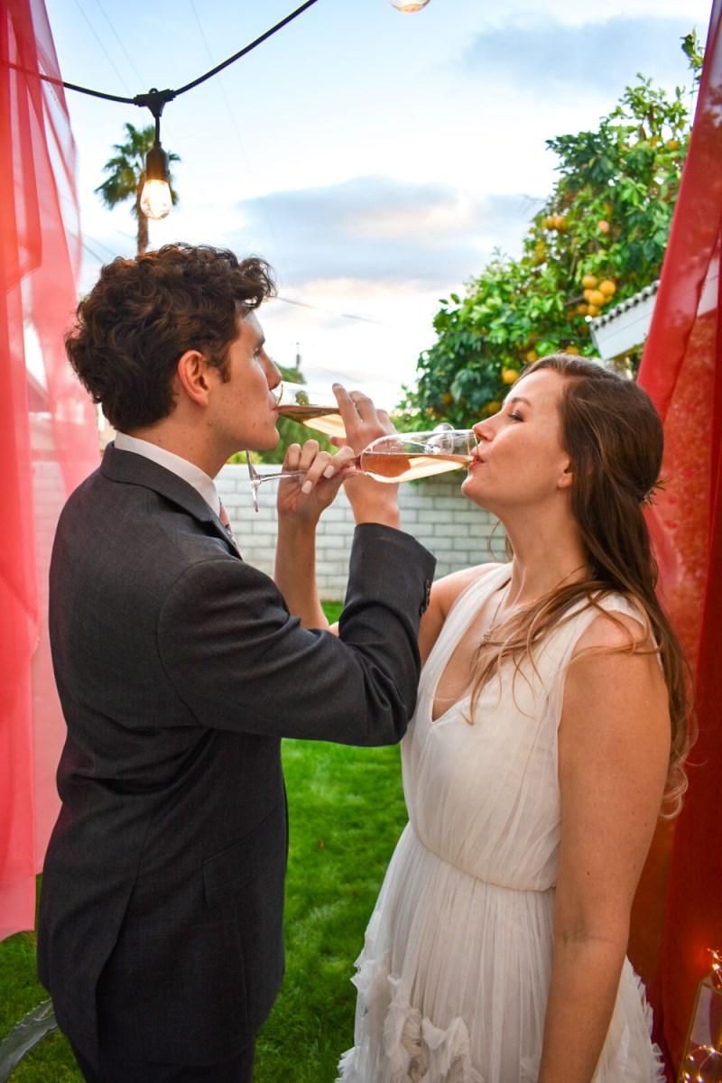 wedding champagne toast at dusk