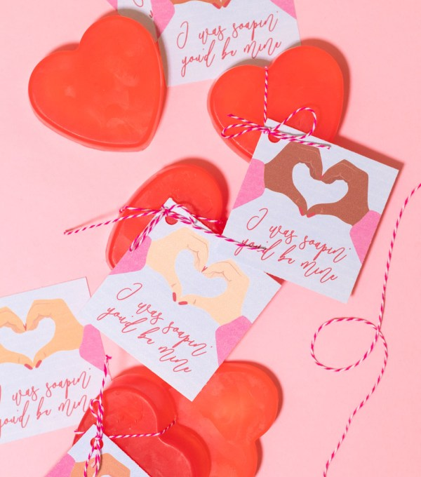 covid valentines with soap arranged on pink background