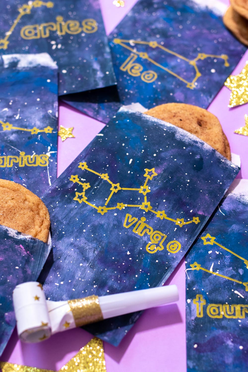 arrangement of zodiac treat bags for party with stars