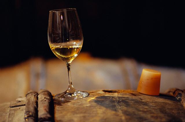 Wine Glass Resting on Barrel