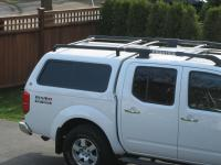 Roof rack for camper shell