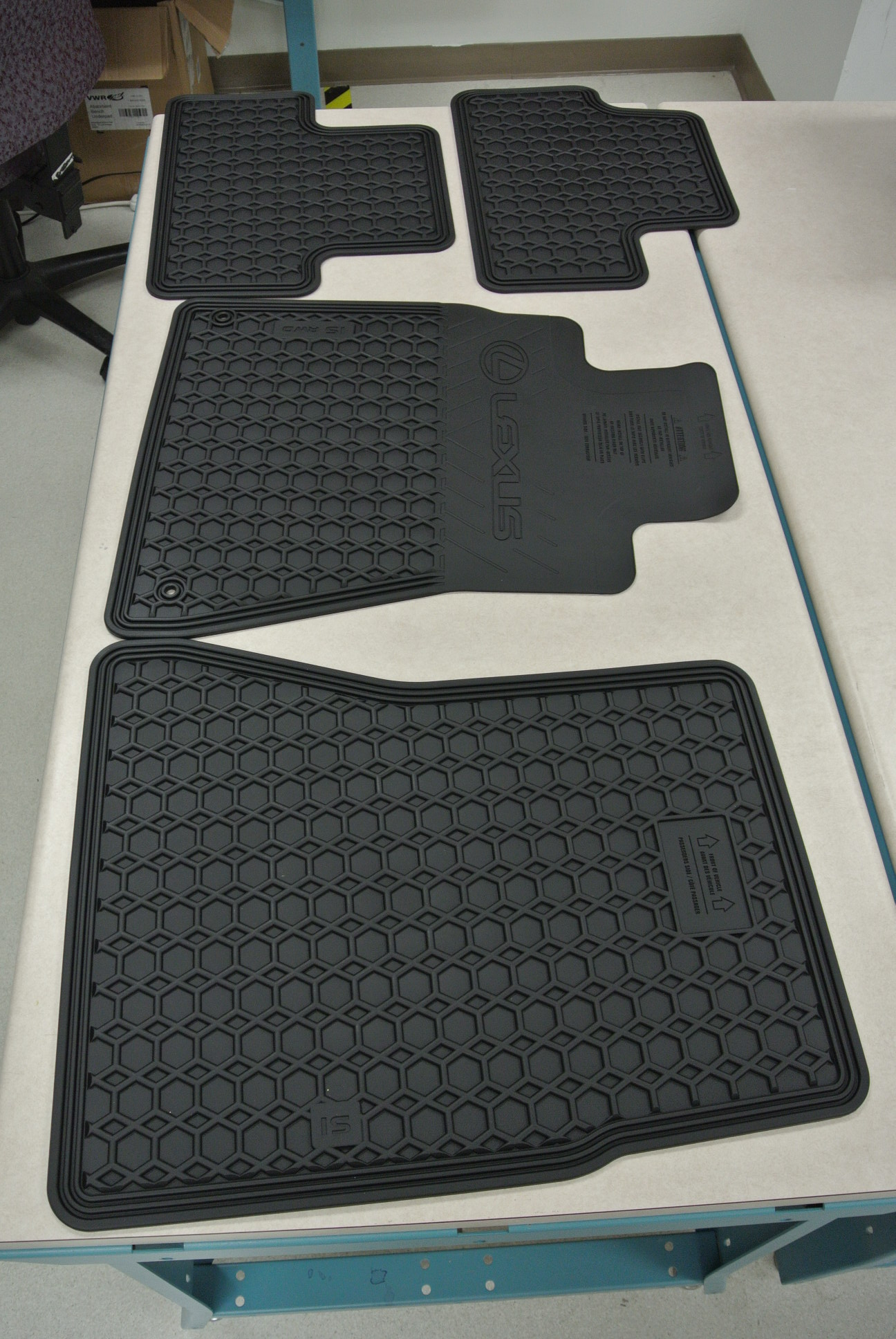 Defective OEM IS250 all weather mats from Sewell Parts