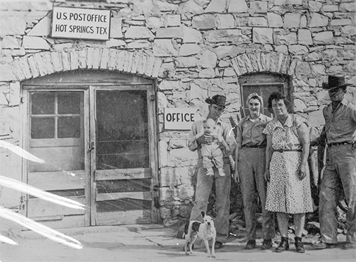 B&W photo of Maggie and her family standing in front of the Hot Springs, Texas, post office, courtesy of Byron Smith