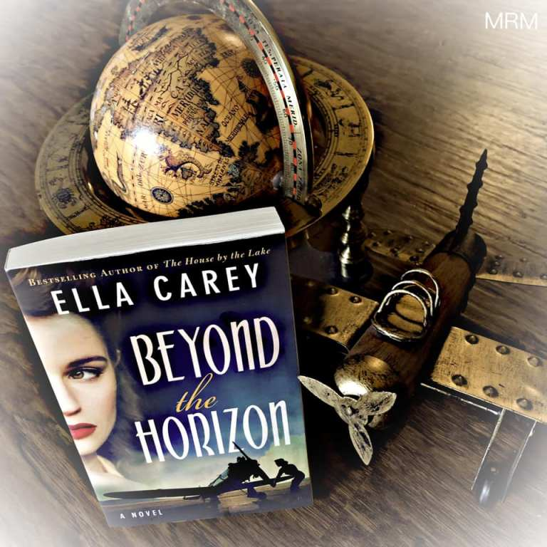 Bookstagram: paperback book is shows leaning on an antique globe and tin airplane.