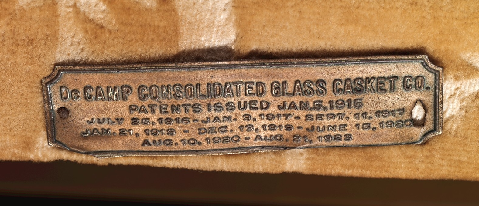 Patent Information Plate on CMoG Casket for DeCamp Consolidated Glass Casket Co., Factory