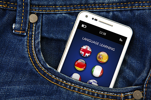 mobile phone with language learning application in jeans pocket