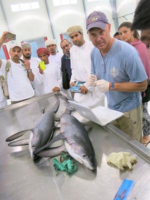 John Carlson provides training at the fish market