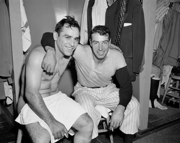 Yogi Berra and Joe DiMaggio smoking in the clubhouse after the world series