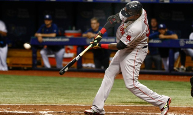 Sep 12, 2015; St. Petersburg, FL, USA; Boston Red Sox designated hitter David Ortiz (34) hits his 500th home run during the fifth inning of a baseball game against the Tampa Bay Rays at Tropicana Field. Mandatory Credit: Reinhold Matay-USA TODAY Sports