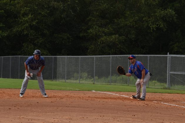 Angel Casiano holds Damon Herbert at first base in the Mets vs. Rebels game on 8/22/2020