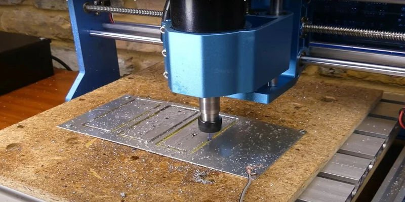 A CNC machine cutting dimensions specified from the original design file