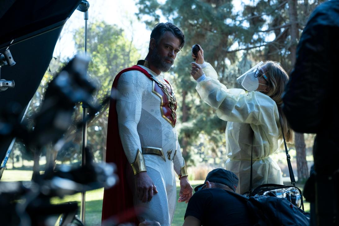 Josh Duhamel with cape and Covid precautions during reshoots.