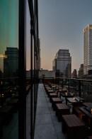archer-hotel-new-york-spyglass-rooftop-bar-dusk-reflection