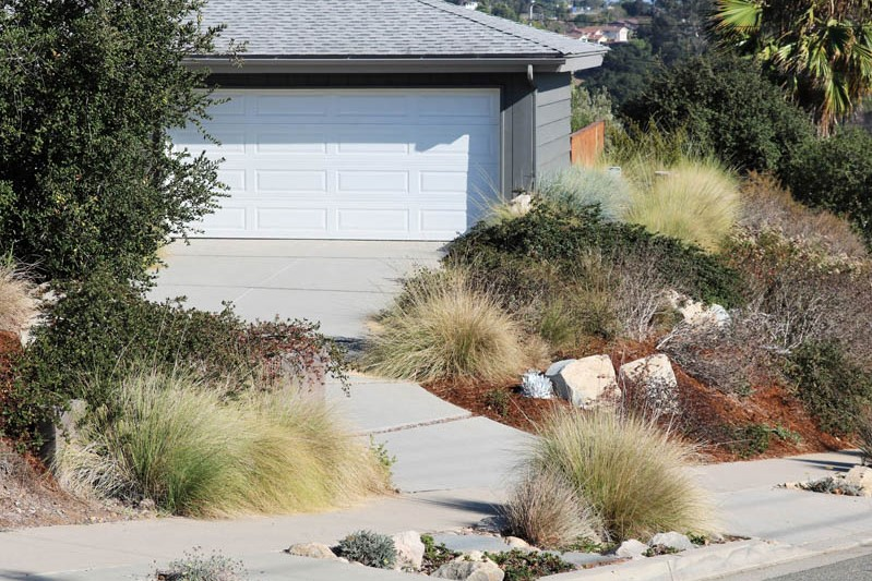 Streetview with permeable driveway and deergrass