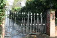 Modern front door metal art swings driveway iron entry ...