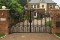 Contemporary metal front door entry double driveway gates ...