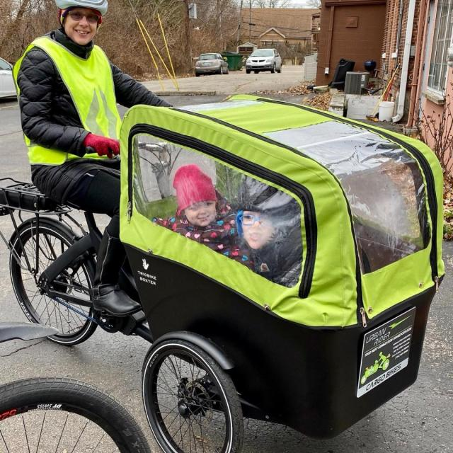 A grandmother carries grandchildren on a three-while cargo bicycle. Source: Urban Cargo Bikes.A grandmother carries grandchildren on a three-while cargo bicycle. Source: Urban Cargo Bikes.