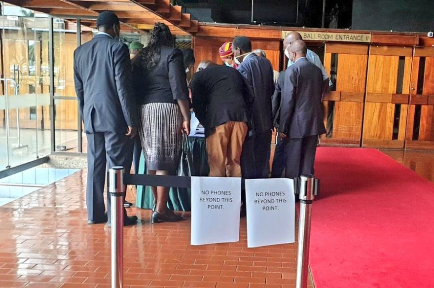 Jubilee MPs register their attendance for today's Parliamentary Group meeting ahead of President Uhuru Kenyatta's arrival at KICC.