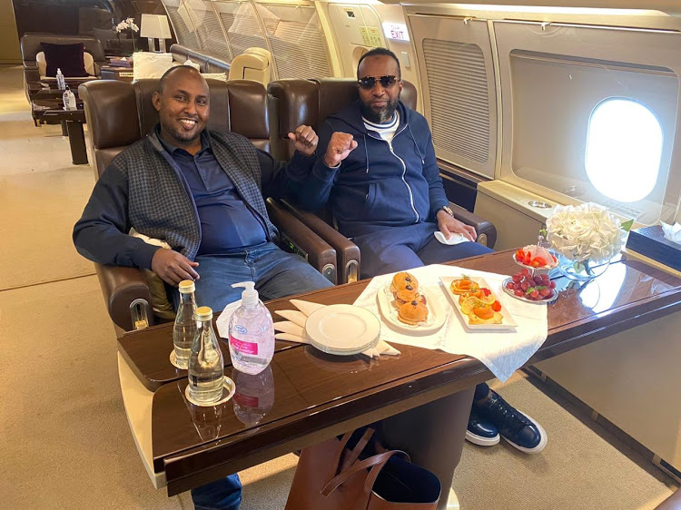 Mombasa Governor Hassan Joho (right) and Suna East MP Junet Mohammed on board a private jet enroute to Dubai to visit ODM party leader Raila Odinga: Peep the brown bag under the table