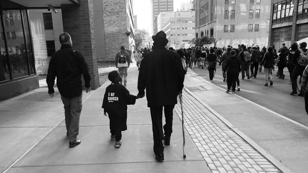Father and son marching for Black lives, May 31, 2020, Syracuse NY.