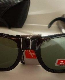 http://articulo.mercadolibre.com.ar/MLA-615070212-lentes-de-sol-negros-wayfarer-con-estuche-retro-nuevos-_JM