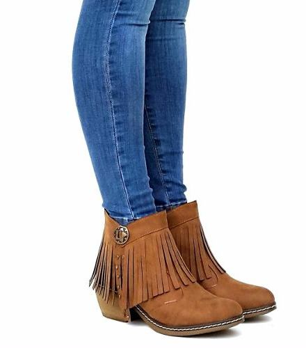 http://articulo.mercadolibre.com.ar/MLA-615179160-botas-mujer-con-flecos-suela-de-goma-cuero-_JM