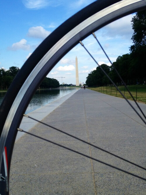 Investing in Expensive Market - Guy on Fire - view of the Washington Monument while riding bike