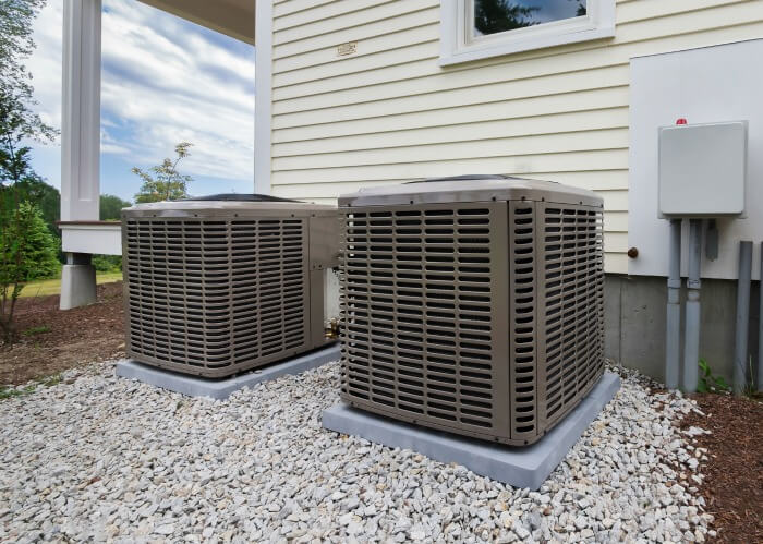 Ultimate Guide to HVAC Systems For Rental Properties - compressors outside