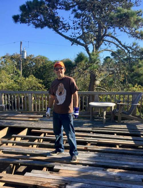 working on deck of vacation rental - He Left His 9-to-5 Job Using Vacation Rentals Near New York City