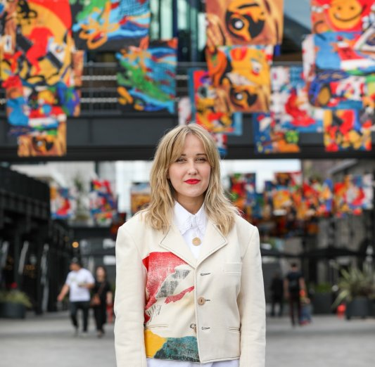 Sustainable fashion designer, humanitarian and artist, Bethany Williams, unveils Coal Drops Yard's striking new flag installation, marking the designer's first ever large-scale artwork. A continuation of Williams' acclaimed fashion collection that launched at London Fashion Week 2021. The installation is comprised of 90 colourful, illustrated flags, which stretch between the iconic roofs of Coal Drops Yard. The artwork is the first life of the flags, and they will then be re-purposed into a limited edition, unisex fashion collection sold in Kiosk N1C in Coal Drops Yard and Browns Fashion.