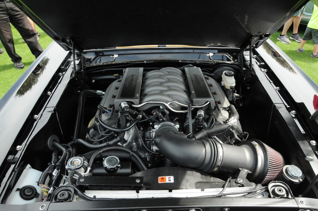 A peak under the hood of Revology's Mustang replica.
