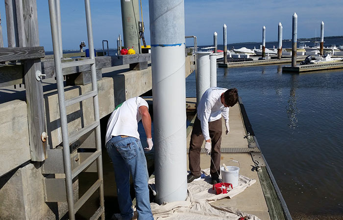 On The Dock Of The Bay Coating Yacht Club Pilings