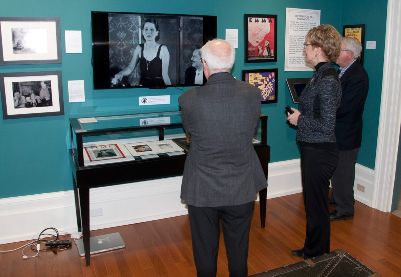 Lou Rinaldi and Minister Daiene Vernile watching one of Museum's exhibits