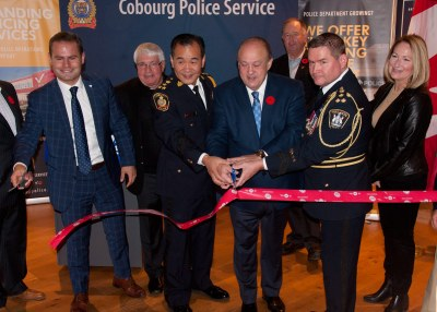 MPP Piccini, Police Chiefs and Minister Tibollo symbolically cutting red tape