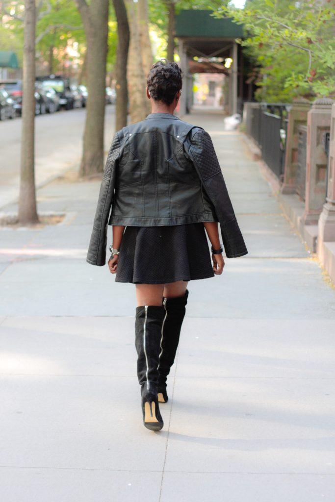 leather jacket sequin tshirt black miniskirt OTK boots mirrored aviators spring 2016 style back view