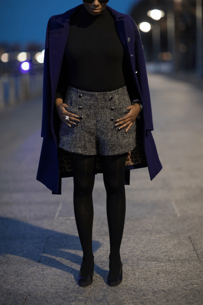 purple military coat black turtleneck bodysuit boucle shorts black tights chanel slingbacks nyc winter fashion 2016