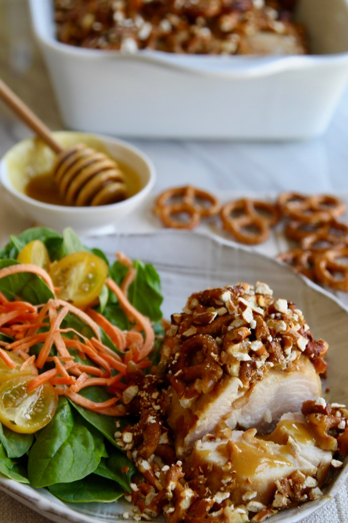 Pretzel Honey Mustard Chicken sliced with pan and dipping sauce